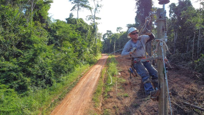 Lineman Mike Teter of Yellowstone Valley Electric Cooperative works on a pole near Villa Cotoca, Bolivia.