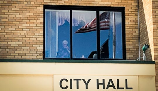 """Doris Ehli talks to family members by phone recently from her apartment in Shelby. Relatives were visiting from California and said they couldn't go home without seeing """"Gramma."""""""