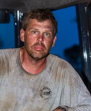 The face of lineman Mike Teter of Yellowstone Valley Electric Cooperative tells the story after a 14-hour workday in Bolivia.