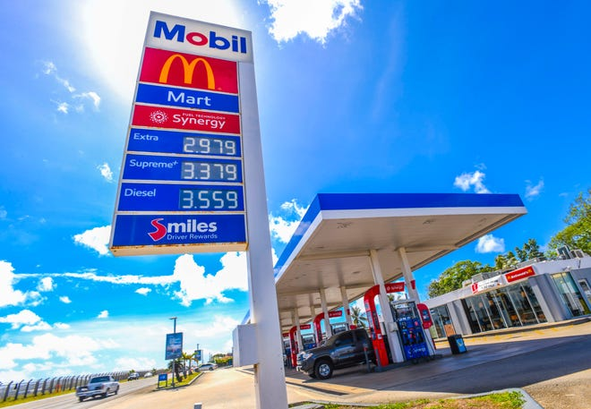 Reduced fuel prices are reflected on a sign at the Mobil gas station along Route 8 on Friday, April 24. 2020.