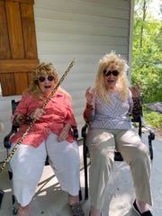"""Twisted Sisters Shirley """"Nenie"""" Mozingo, left, and Lucille """"Grandma Cille"""" Barraza dress up for one of their TikTok videos that have gone viral since they made their debut this year. The sisters are pictured outside Mozingo's Hattiesburg home, where the videos are shot, usually in one take."""