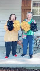 """Twisted Sisters Shirley """"Nenie"""" Mozingo and Lucille """"Grandma Cille"""" Barraza practice their cheers for one of their TikTok videos that have gone viral since they made their debut this year. The sisters are pictured outside Mozingo's Hattiesburg home, where the videos are shot, usually in one take."""