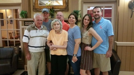 Roger Mirgon, far left, stands with members of his family. Mirgon, 79, died from injuries sustained in an Easter Sunday tornado that struck his home in Walthall County, Miss., on April 12, 2020.