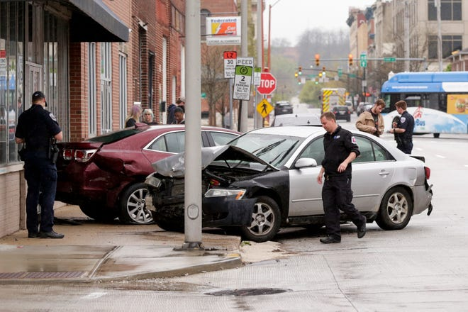 Lafayette Police work the scene of a car crash at the intersection of Third and Brown Streets, Thursday, April 23, 2020 in Lafayette.
