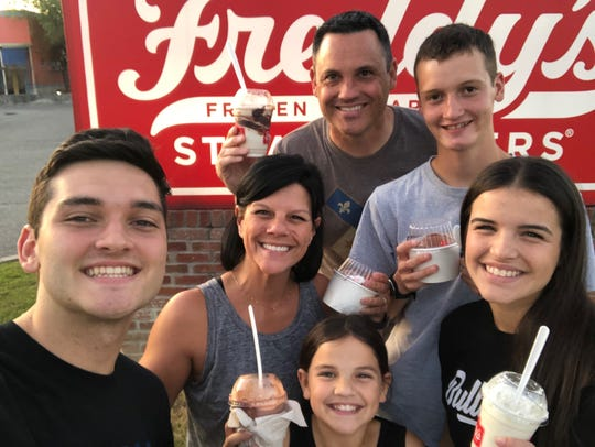Stan Melton and Audrey Laper, stepsiblings and seniors at David Thibodaux STEM Magnet Academy, enjoy treats from Freddy's. While difficult at first, quarantine has allowed them to spend more time together as a family.