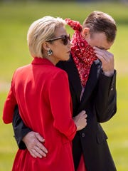 Wayne Long, right, cries alongside Kristin Price as they mourn at the burial of Wayne's father, Rick Long. Rick died of COVID-19 on March 30 and was laid to rest Friday in Resthaven Memorial Cemetery.