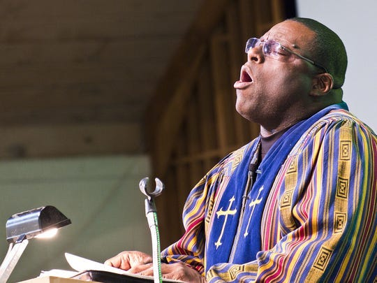 Reverend David Ford, pastor of Friendship House of Prayer Baptist Church, preaches to his congregation in their new church at 4301 S. Waverly Rd. in Lansing on Easter Sunday, March 27, 2016.