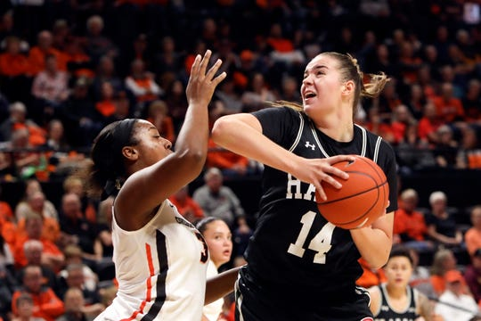 Hawaii's Lauren Rewers (14) tries to get past Oregon State's Madison Washington (3) during the first half of a game in December. Rewers is the newest addition to the Michigan State women's basketball program.