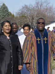 Friendship House of Prayer Baptist Church Pastor David Ford and his wife, Cassandra, lead a procession into their new church building at 4301 S. Waverly Rd. in Lansing on Easter Sunday, March 27, 2016.