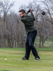 Zach Tranchita of Milwaukee tees off at Wanaki Golf Course in Menomonee Falls on April 24, 2020. Courses across the state were allowed to open at 8:00 a.m. on the April 24 in accordance with Gov. Evers' revised safer-at home order.