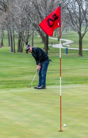 Larry Hertel of Menomonee Falls follows his putt at Wanaki Golf Course in Menomonee Falls last year. Wanaki officials are inviting the community to a grand opening party April 18. The golf course, which was sold to private developers, will feature a renovated clubhouse.