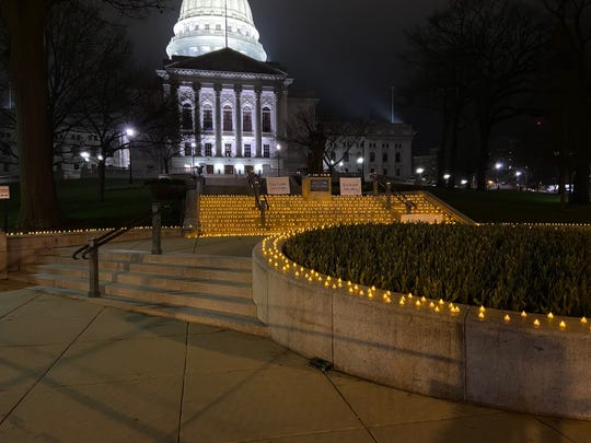Wisconsin health care workers placed more than 1,300 candles on the steps of the State Capitol in Madison onThursday. The workers said the candles represent every person in the state who has been hospitalized with COVID-19. The display is in response to protests against Gov. Tony Evers' safer-at-home order that are scheduled to take place Friday at the Capitol.