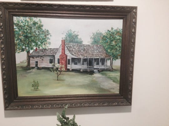 This painting by Vaska Cope shows a house she lived in while growing up. The Mountain Home resident recently celebrated her 101st birthday.