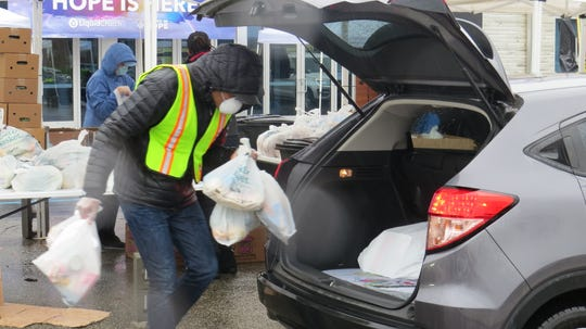 A volunteer effort to distribute food during the coronavirus pandemic continued at the Liquid Church in Parsippany. April 24, 2020.