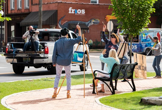 Business owners in downtown Wetumpka, Ala.,  dance in the streets on Friday April 24, 2020, to make a video promoting the business district opening back up when that time comes.