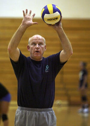 Jim Craig demonstrates hand position during a drill at a Munciana volleyball practice in this photo from 2006.