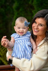 News 2 morning anchor Nikki Burdine gets a big smile from her baby, Andi, at their home in Nashville, Tenn. Thursday, April 23, 2020.