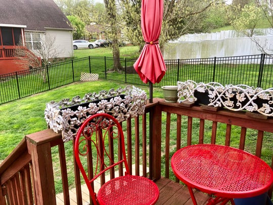 The backyard is enclosed by an aluminum fence.