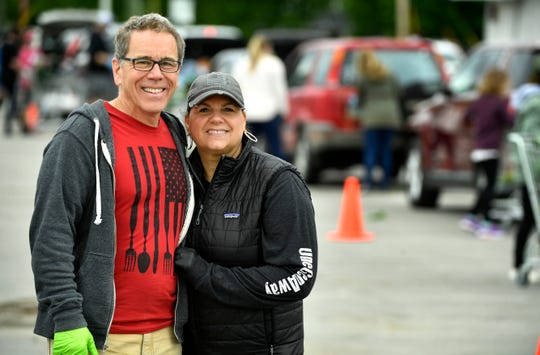 Chris and Elaine Whitney are founders of One Generation Away, a Christian-based charity that sees its food giveaways draw hundreds of cars for its new drive-thru service during the pandemic.