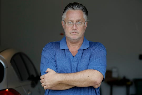 Glenn Barca poses for a photo outside his house Friday, April 24, 2020, in Wesley Chapel. Barca, a self-employed driver for a luxury car service in the Tampa area, says there was no way to keep a six-foot distance from his passengers and he feared what they had been exposed to on an airplane and at the airport. He stopped picking up passengers at the airport on March 20.