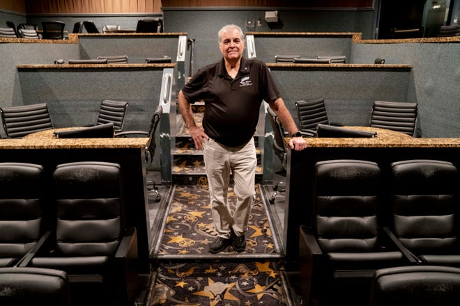 Nick Campo, owner of Marco Movies, poses for a portrait in one of his dine-in theaters in Marco Island on Friday, April 24, 2020. Marco Movies closed on March 17 in response to coronavirus, and Campo has received multiple small business loans that he says will help him to cover most of his expenses and let him keep paying his employees.
