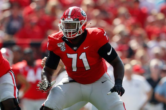 In this Sept. 7, 2019, file photo, Georgia offensive lineman Andrew Thomas (71) is shown in action during the first half of an NCAA college football game against the Murray State, in Athens, Ga. Thomas was selected to The Associated Press All-American team, Monday, Dec. 16, 2019.