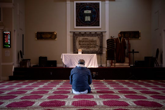 Yassin Al-Attia, of Midland Park, prays during the first Friday of Ramadan at the El-Zahra Islamic Center in Midland Park on Friday, April 24, 2020. Al-Attia was one of seven people praying at the mosque.