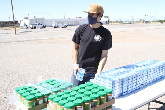 Roadrunner Food Bank volunteered to distribute food to those in need at the Fairgrounds in Alamogordo on April 24, 2020.