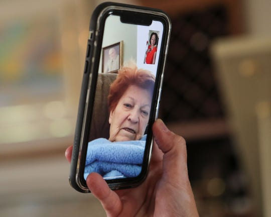 Katie Finn has a video call with her grandmother Carole Gowdy.  Finn who lives in La Quinta is unable to see her grandmother who lives at the Legend Gardens Assisted Living and Memory Care in Palm Desert because of coronavirus concerns, April 24, 2020.