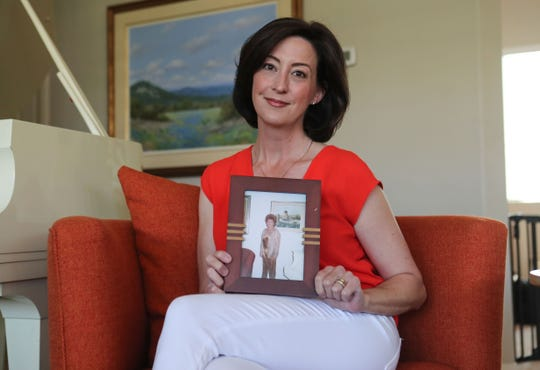 Katie Finn holds a picture of her grandmother Carole Gowdy in her La Quinta home, April 24, 2020.