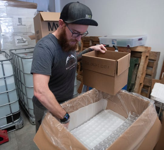 Patrick Rollins, the co-owner of Rollins Distillery in Gulf Breeze, continues to make and bottle hand sanitizer on Friday, April 24, 2020.  In addition to individual size bottles, the company also sells gallon-sized bottles.