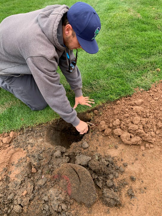 Pensacola Blue Wahoos groundskeeper Dustin Hannah helps restore Pohlman Field in Beloit, Wisconsin, home of the Beloit Snappers of the Midwest League, amid the 2020 COVID-19 global pandemic.