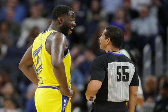 Golden State Warriors forward Draymond Green, left, talks with referee Bill Kennedy (55) during the second half of an NBA basketball game between the Warriors and the Indiana Pacers in San Francisco, Friday, Jan. 24, 2020. (AP Photo/Jeff Chiu).