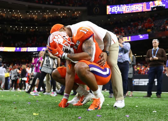 Clemson Tigers linebacker Isaiah Simmons (11) reacts after losing the College Football Playoff national championship game against the LSU Tigers at Mercedes-Benz Superdome.
