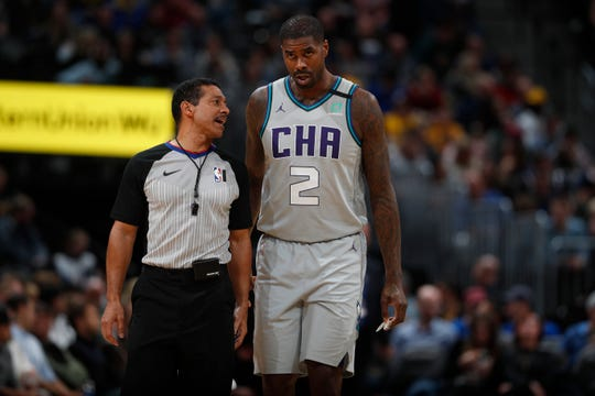 Charlotte Hornets forward Marvin Williams (2) confers with referee Bill Kennedy (55) in the second half of an NBA basketball game Wednesday, Jan. 15, 2020, in Denver. The Nuggets won 100-86. (AP Photo/David Zalubowski).