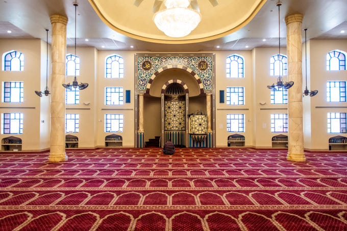 A man prays in the empty mosque at the Islamic Community Center of Arizona on the first day of Ramadan on April 24, 2020. The massive decrease in attendance due to the new coronavirus pandemic means a decrease in donations during Ramadan.