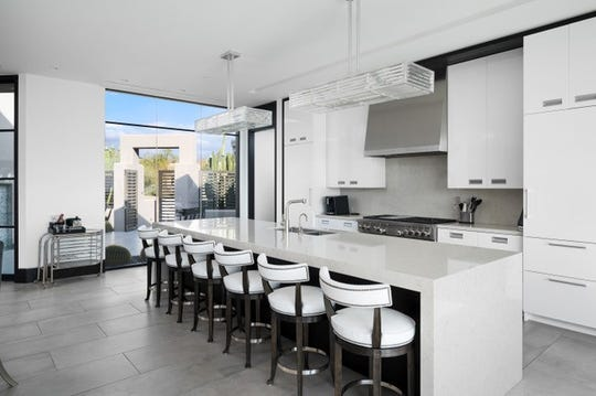 The $3.7M Scottsdale estate, sold by Daniel Whitney, features a gourmet kitchen with an oversized kitchen island.