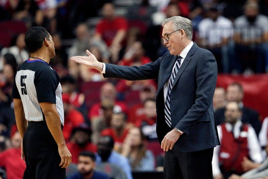 Houston Rockets head coach Mike D'Antoni, right, questions a call to referee Bill Kennedy, left, during the first half of an NBA basketball game against the Orlando Magic Sunday, March 8, 2020, in Houston. (AP Photo/Michael Wyke).