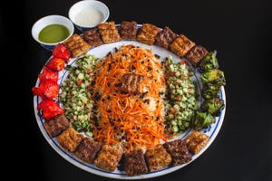 Kebab platter with biryani rice at Hilal Grill restaurant in Phoenix, located at 1638 N. 40th Street. 602-275-1815, hilalgrill.com.