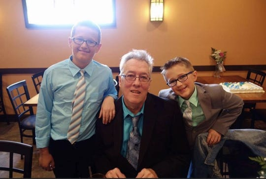 Earl Denbow Jr. poses with his grandsons in a photo from 2016. Denbow on April 1 died in Pennsylvania nursing home after being infected with COVID-19.