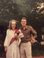 Earl Denbow Jr. stands with his daughter, Keri Boyer, on her high school graduation day in 1992. Denbow died earlier this month at a Pennsylvania nursing home after being infected with COVID-19.