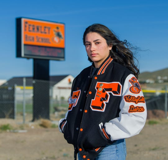 Fernley High School senior Tali Bertinuson stands outside the campus.