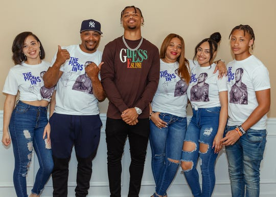 Atlanta Falcons 2020 NFL Draft pick A.J. Terrell, center, with father Aundell Sr., second from left, mother Aliya, third from right, and siblings Ariel, Arieaunna and Avieon.