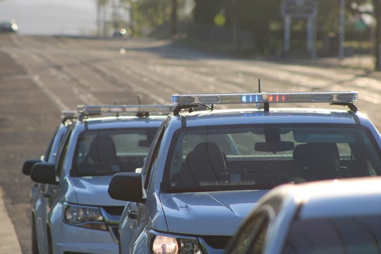 Redding Police Department cars sit parked along Cypress Avenue as officers investigate two suspicious deaths at a Bunker Street home on Thursday, April 23, 2020.