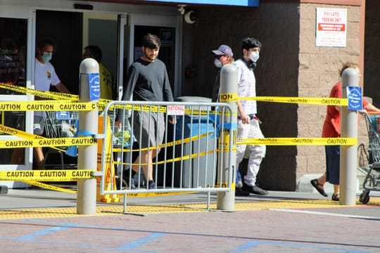 Some shoppers at stores like Walmart and Costco in Redding wore masks while others went without protective coverings on Thursday, April 23, 2020.