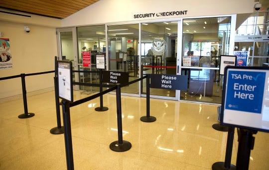 A security checkpoint at the San Angelo Regional Airport, seen in this Friday, April 24, 2020 photo, sits empty amid drastic reductions in the level of commercial airline travel due to the coronavirus.