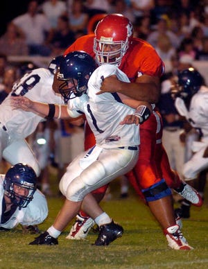 Fromer Haughton's Jace Prescott (top), at 6-foot-6, 343 pounds, played offensive linemanfor Northwestern State from 2008-10.