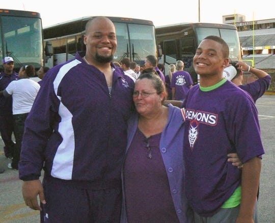 Jace Prescott (left) and Dak Prescott (right) pose with relative Pam Ebarb after a Northwestern State football game.