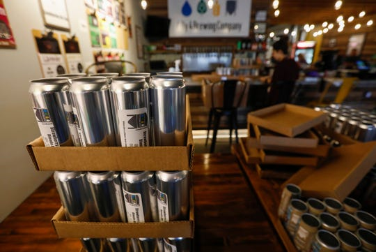Empty cans of beer sit on a table waiting to be filled for customers at 4 By 4 Brewing Company on Friday, April 24, 2020.
