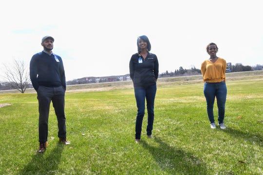 Community health liaisons Kahin Adam, Hani Jacobson and Mahado Ali pose for a photograph Thursday, April 23, 2020, in St. Cloud.